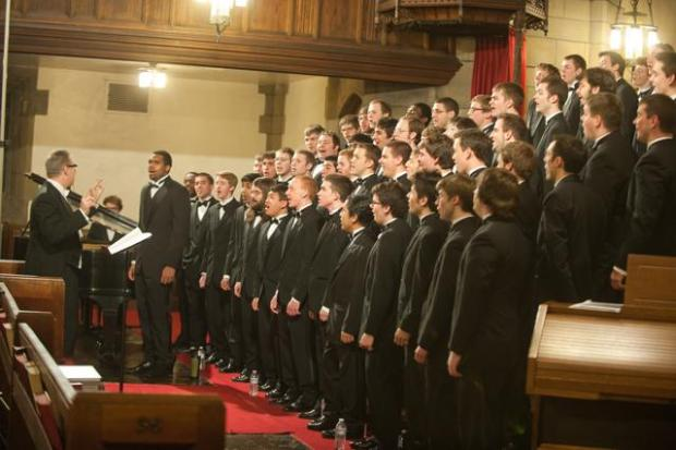 Richard Teaster (left) conducting a performance of the Pitt Mens' Glee Club Photo via Pitt Mens' Glee Club site