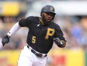 Josh Harrison hasn't provided much return yet on his extended contract. Photo -- Charles LeClaire-USA TODAY Sports